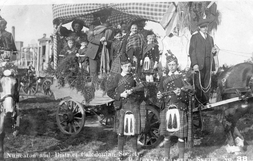 Car decorated for a Caledonian Society celebration, children in Scottish costume, Nuneaton.  1900s |  IMAGE LOCATION: (Warwickshire County Record Office)