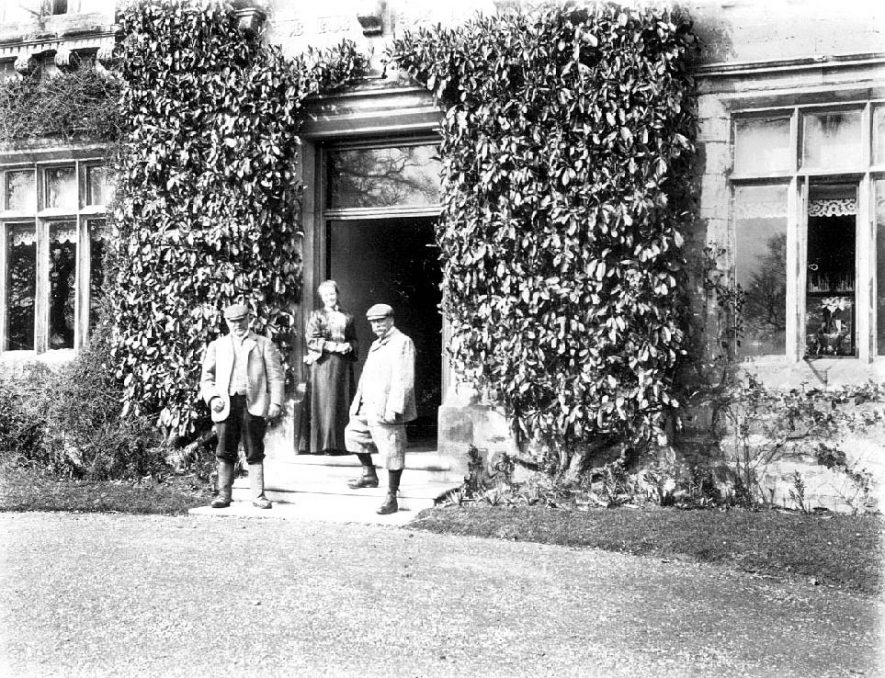 Tom Ledbrook, Stanley Ledbrook and Miss Foll standing at the entrance to Woodloes House.  circa 1890 |  IMAGE LOCATION: (Warwickshire County Record Office) PEOPLE IN PHOTO: Ledbrook, Tom, Ledbrook, Stanley, Ledbrook as a surname, Foll, Miss, Foll as a surname