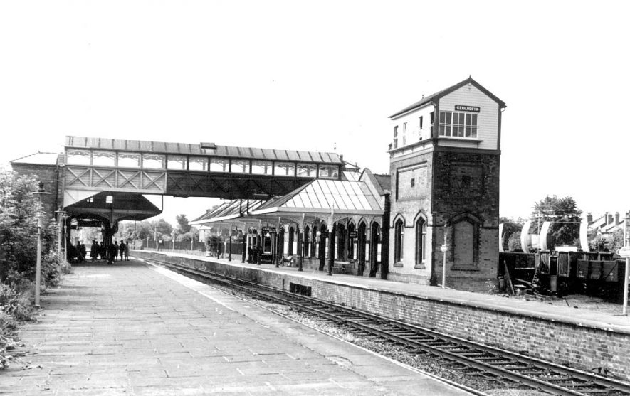 Kenilworth Station, showing line, platforms, footbridge, booking hall and signal box.  1963 |  IMAGE LOCATION: (Warwickshire County Record Office)