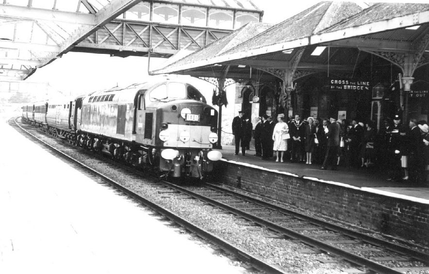 Kenilworth railway station. Arrival of Royal train bringing Queen Elizabeth to Royal Show at Stoneleigh. Queen on platform with mayor and others.  4th July 1963 |  IMAGE LOCATION: (Warwickshire County Record Office) PEOPLE IN PHOTO: Elizabeth II