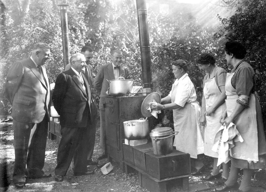 Emergency feeding exercise at Rugby, showing Ald. S.G. Gibson, Cllrs. J.H. Walker, J. Stott and Mr T.C. Duffy and Mrs Nicholas, for Hillmorton; Mrs E. Heath, for Princethorpe. Mrs C. Rhead.  24 September 1955 |  IMAGE LOCATION: (Warwickshire County Record Office) PEOPLE IN PHOTO: Rhead, Mrs C, Rhead as a surname, Heath, Mrs, Heath as a surname, Gibson, Ald S G, Gibson as a surname, Duffy, Mr T L, Duffy as a surname