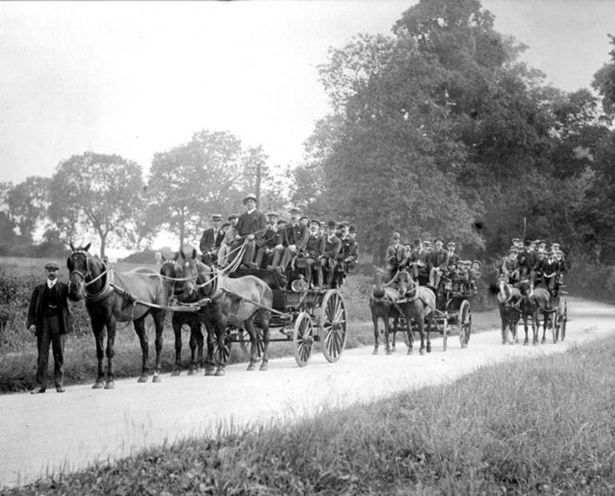 Lad's day out ! Three horse drawn charabancs full of men being led by Mr Durham. Rugby.  1900s    IMAGE LOCATION: (Warwickshire County Record Office) PEOPLE IN PHOTO: Durham, Mr, Durham as a surname