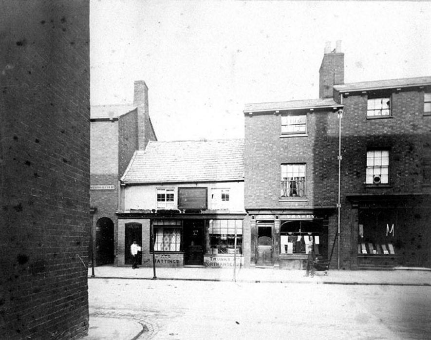 Shops in Windsor Court, Rugby.  Taken around 1911. [It has been pointed out that this  view is looking from Dukes Jetty across the High Street towards the alleyway that leads to Windsor Court. It is not a picture of Windsor Court] |  IMAGE LOCATION: (Warwickshire County Record Office)