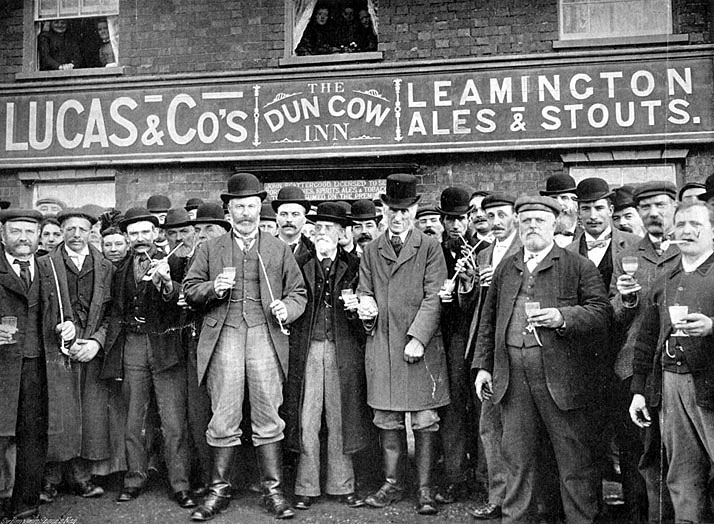 Group of men standing outside the Dun Cow Inn, Stretton on Dunsmore.  The licensee was John Scattergood.  The picture is entitled -