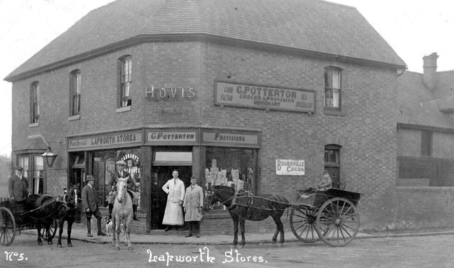 The Stores at Lapworth, owned by C. Potterton. This was the post office, grocers and provision merchants and also a corn factory.  There are two horse and carts standing outside and also a gentleman on horseback.  1900s |  IMAGE LOCATION: (Warwickshire County Record Office)