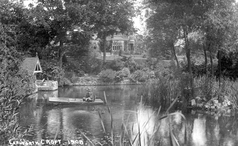 View of Lapworth Croft with boating lake and boathouse.  1908 |  IMAGE LOCATION: (Warwickshire County Record Office)