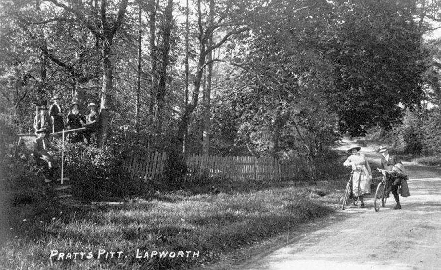 Country lane at Pratt's Pitt, Lapworth. Two cyclists in foreground.  1910s |  IMAGE LOCATION: (Warwickshire County Record Office)