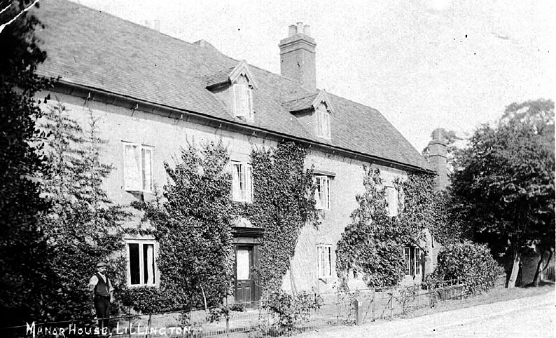 Old Manor House, Lillington, with man standing in front.  1910s |  IMAGE LOCATION: (Warwickshire County Record Office)
