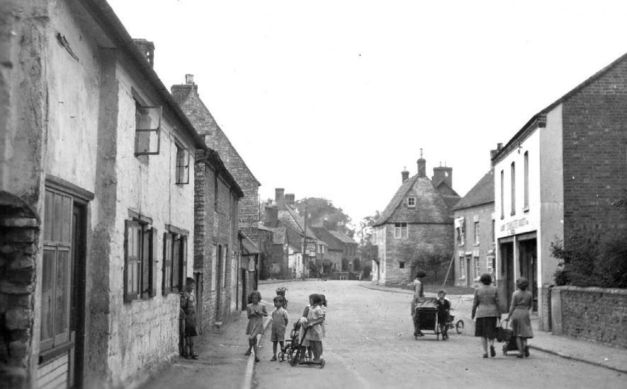 Harbury, Mill Street; children playing in the road with a pram, pushchair, scooter etc.  1930s    IMAGE LOCATION: (Warwickshire County Record Office)