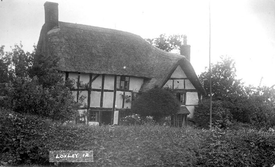 Timber framed, thatched cottage in Loxley.  1920s |  IMAGE LOCATION: (Warwickshire County Record Office)