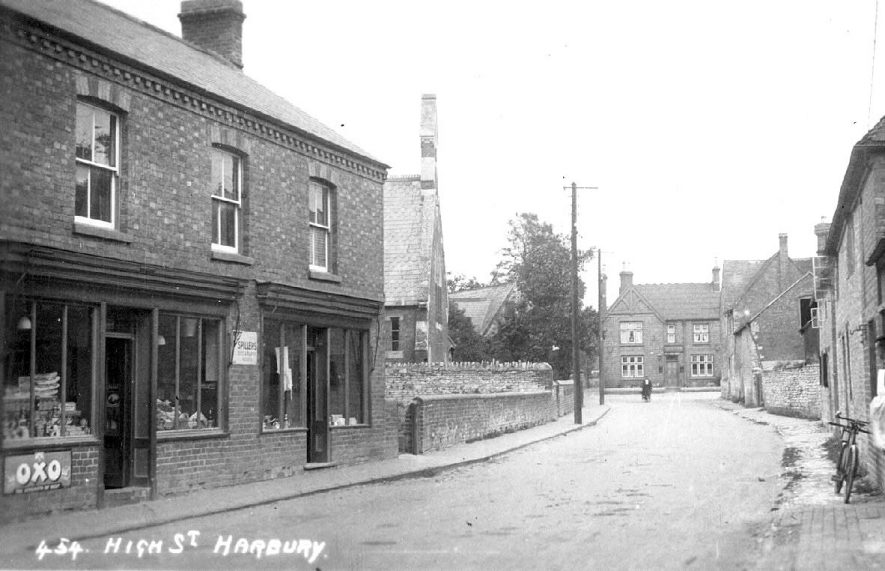 View along the High Street, Harbury, looking east; general stores and Rev. Wight's school on the left.  1910s |  IMAGE LOCATION: (Warwickshire County Record Office)