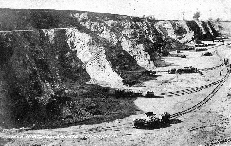 Hartshill Quarries of Granite & brick Co. showing rail tracks and trucks.  1911 |  IMAGE LOCATION: (Warwickshire County Record Office)