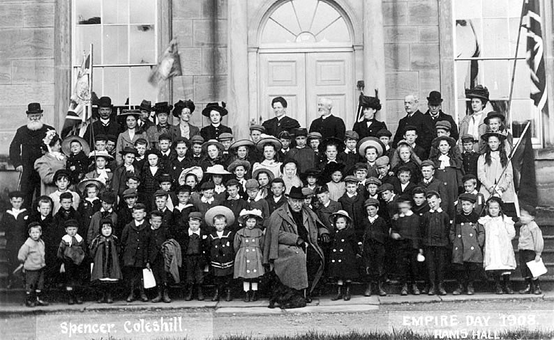 A large group of people outside the front door of Hams Hall on Empire Day, Lea Marston.  1908 |  IMAGE LOCATION: (Warwickshire County Record Office)