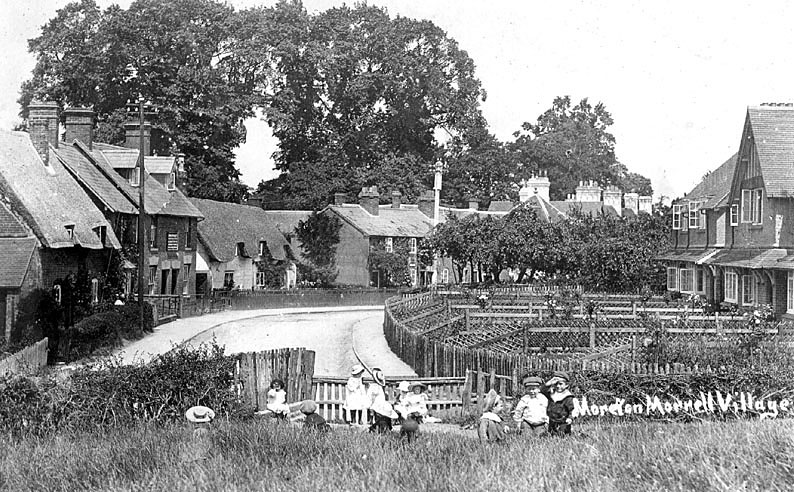 Group of children playing in a field with cottages behind in Moreton Morrell.  1900s |  IMAGE LOCATION: (Warwickshire County Record Office)