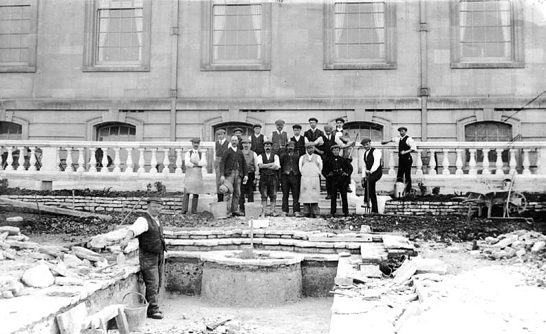 Group of workmen standing on newly built terrace and steps in front of Moreton Hall, Moreton Morrell.  1900s |  IMAGE LOCATION: (Warwickshire County Record Office)