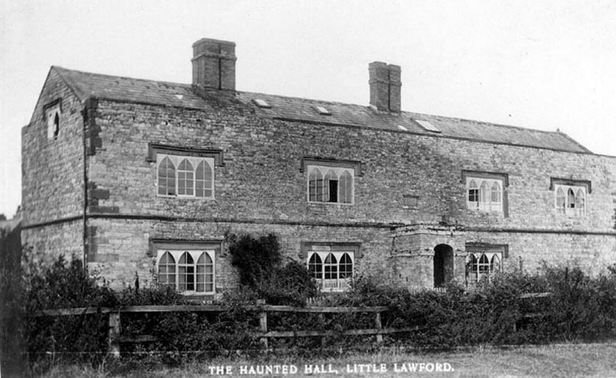 Large stone built house showing quoins, drip mouldings and gothic fenestration.  1910s |  IMAGE LOCATION: (Warwickshire County Record Office)