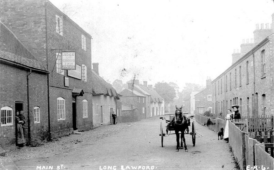 Street scene in Long Lawford at the beginning of the 20th century. The public house on the left of the photograph is the Rose and Crown Inn.  The name on the bottom of the inn sign reads J.T. Pettifer.  1900s |  IMAGE LOCATION: (Warwickshire County Record Office)