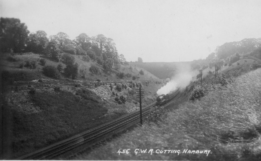 G.W.R. cutting and bridge, Harbury. Steam train on track.  1920s |  IMAGE LOCATION: (Warwickshire County Record Office)
