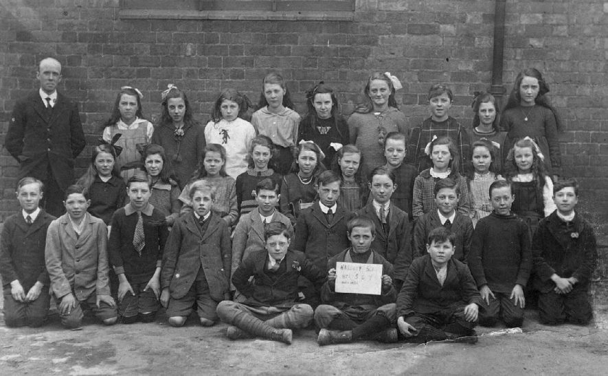 Harbury School group photograph of boys and girls with teacher.  1921 |  IMAGE LOCATION: (Warwickshire County Record Office)