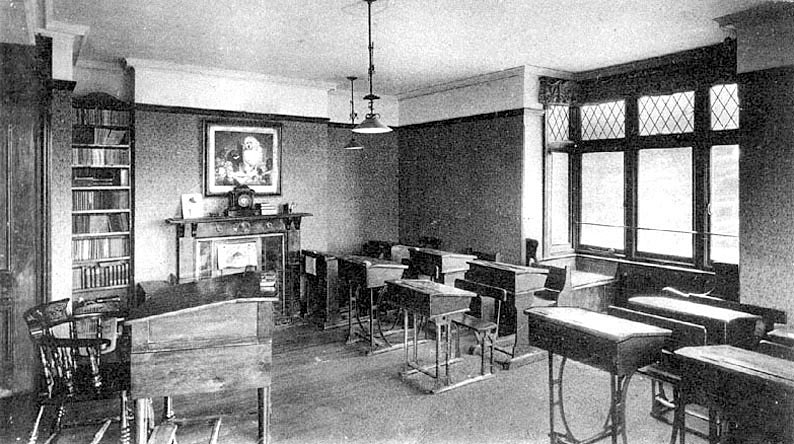 Interior of upper school classroom Packwood Haugh.  1910s |  IMAGE LOCATION: (Warwickshire County Record Office)