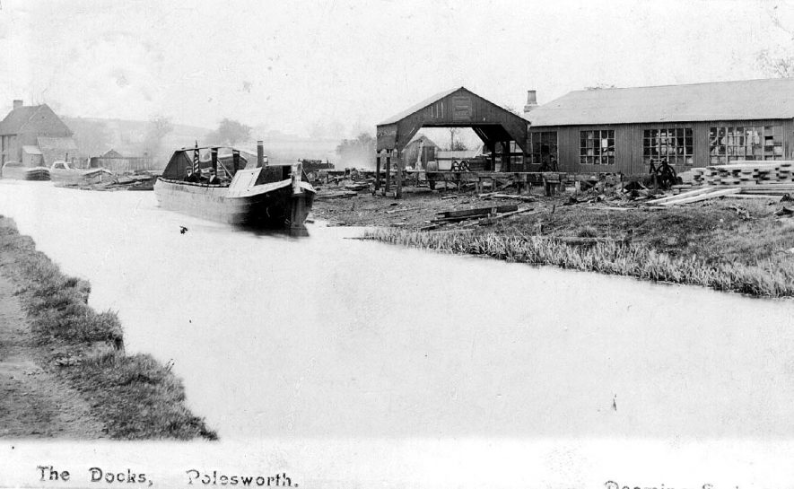 Work boat on the Coventry canal at the docks in Polesworth with wharf alongside.  1900s |  IMAGE LOCATION: (Warwickshire County Record Office)