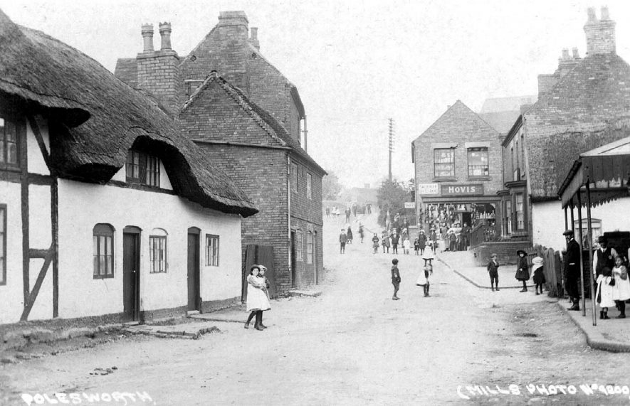 Market Street, Polesworth, showing on the right, Foster's outfitters, Bond's off licence and Randles grocery store.  1900s |  IMAGE LOCATION: (Warwickshire County Record Office)