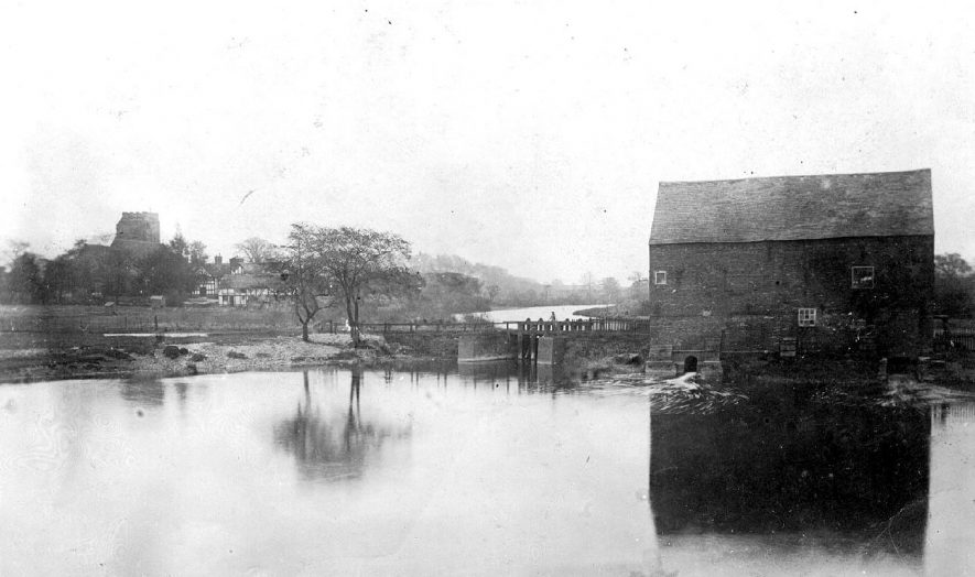 View from river bridge showing the water mill and its sluices, Polesworth.  1900s |  IMAGE LOCATION: (Warwickshire County Record Office)