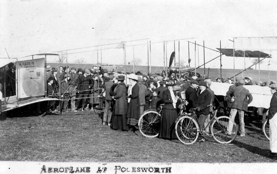 Avery early Farman biplane on display, surrounded by a crowd of people, Polesworth.  1900s |  IMAGE LOCATION: (Warwickshire County Record Office)