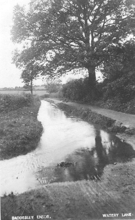 Watery Lane, Baddesley Ensor.  Lane with stream running alongside.  1900s |  IMAGE LOCATION: (Warwickshire County Record Office)