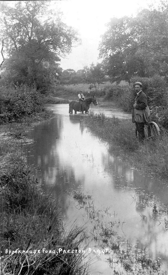 Brookhouse Ford, Preston Bagot. Man on horseback crossing the ford and second man with a bicycle.  1900s. |  IMAGE LOCATION: (Warwickshire County Record Office)