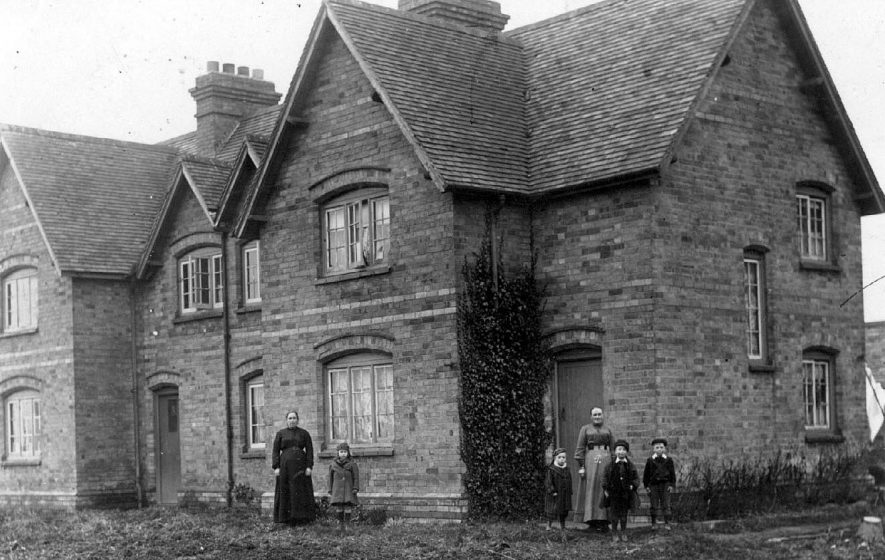 Semi-detached property in Preston On Stour with family group.  1910s |  IMAGE LOCATION: (Warwickshire County Record Office)
