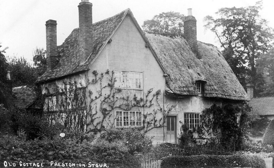 Cottages at Preston on Stour, the left hand one shows some timber framing on the side elevation.  1900s |  IMAGE LOCATION: (Warwickshire County Record Office)