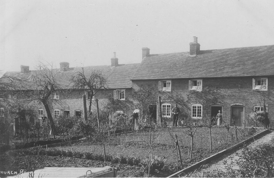 Row of cottages at Church Row with their gardens, including a cold frame in the foreground.  1900s |  IMAGE LOCATION: (Warwickshire County Record Office)