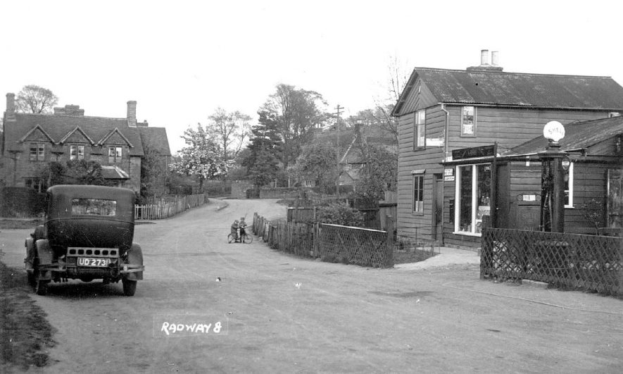 Petrol station and saloon car in Radway village street.  1930s |  IMAGE LOCATION: (Warwickshire County Record Office)