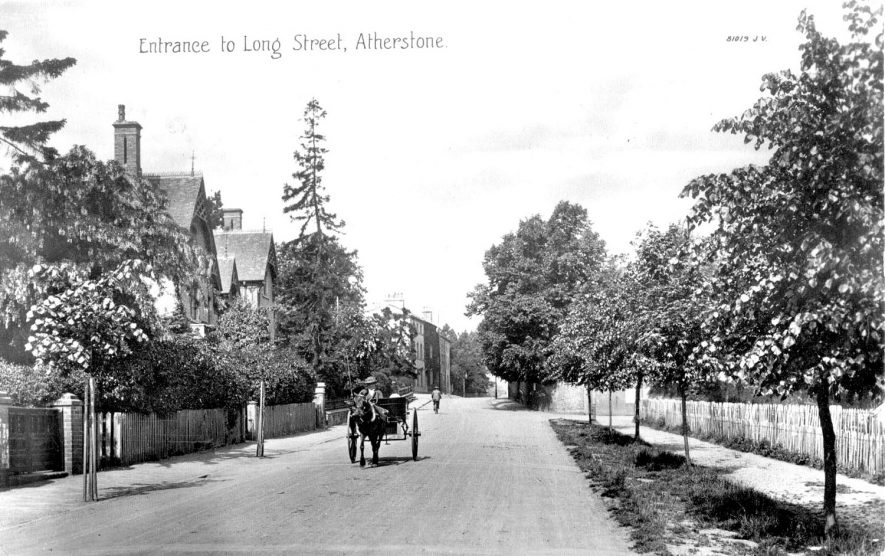 Entrance to Long Street, Atherstone, tree-lined street with houses, horse and trap.  1910s |  IMAGE LOCATION: (Warwickshire County Record Office)
