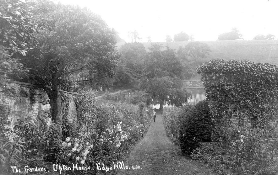 Herbaceous border at Upton house with gardener.  1900s    IMAGE LOCATION: (Warwickshire County Record Office)