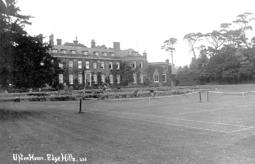 Front of Upton House with two lawn tennis courts on the lawn.  1910s |  IMAGE LOCATION: (Warwickshire County Record Office)