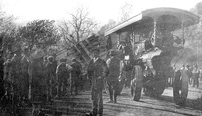 Photograph entitled 'Accident to Menagerie at Sunrising, going from Banbury to Stratford on Avon, May 12th 1910 with two vans full of wild animals and animal freaks, and another containing the retainers, all  drawn by a powerful engine'. |  IMAGE LOCATION: (Warwickshire County Record Office)