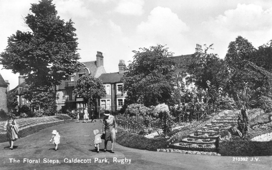Children in their summer bonnets next to the 'Floral Steps' in Caldecott Park, Rugby.  1930s |  IMAGE LOCATION: (Warwickshire County Record Office)