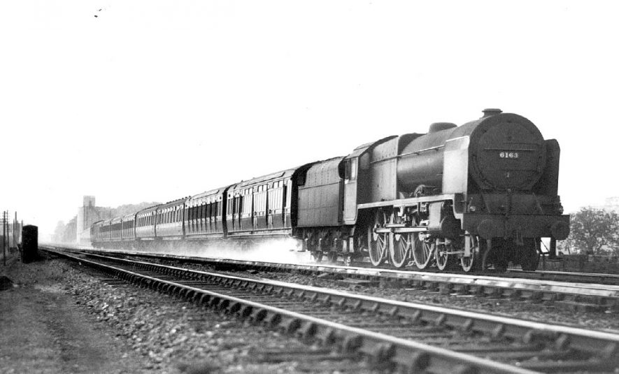 Steam train 6163,'Civil Service Rifleman' Liverpool and Leeds express  taking water at Rugby troughs.  1940s |  IMAGE LOCATION: (Warwickshire County Record Office)