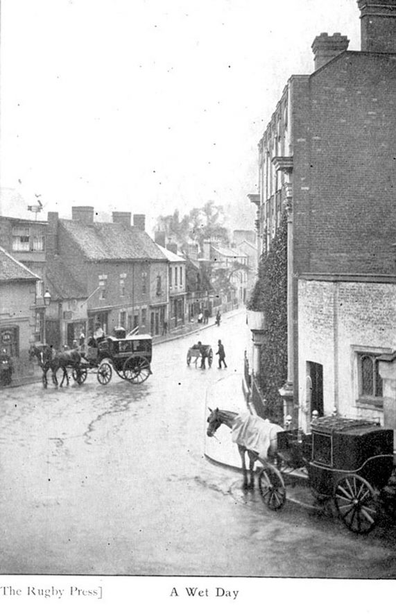 North Street, Rugby, showing horse-drawn vehicle and delivery man outside public house with group of children and perambulator.  1900s