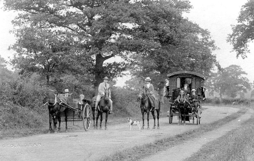 Horse drawn caravan  with pony and trap, horse riders and a dog on a country lane.  1900s |  IMAGE LOCATION: (Warwickshire County Record Office)