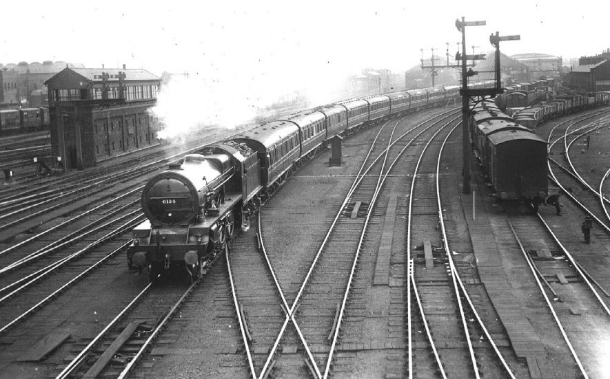 Royal Scot passing through Rugby Station.  With other wagons, signal boxes and signals in view.  1920s |  IMAGE LOCATION: (Warwickshire County Record Office)