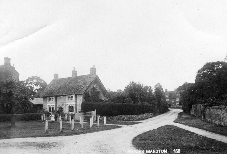 Looking towards the Falcon Inn, house in the foreground.  1900s |  IMAGE LOCATION: (Warwickshire County Record Office)