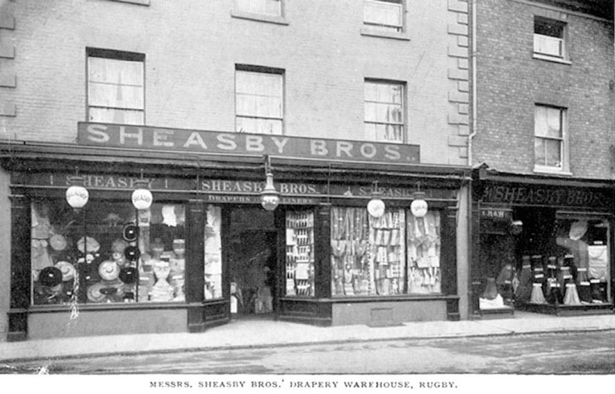 Sheasby Bros. Drapery Warehouse, Sheep Street, Rugby. Shop window filled with goods.  1900s |  IMAGE LOCATION: (Warwickshire County Record Office)