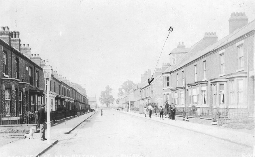 Terraced housing, children on pavement, Lawford Road, New Bilton.  1900s |  IMAGE LOCATION: (Warwickshire County Record Office)