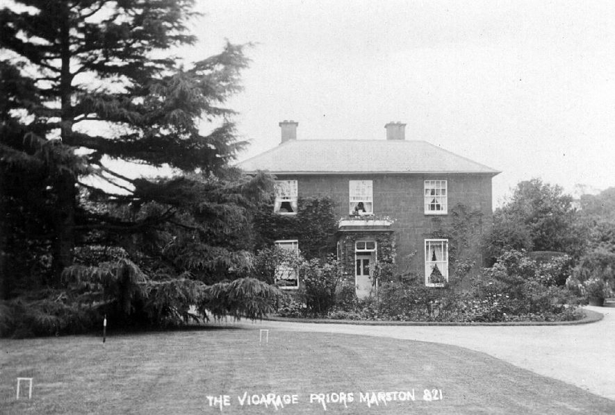 'The Vicarage', showing lawn set up for croquet, Priors Marston.  1910s |  IMAGE LOCATION: (Warwickshire County Record Office)