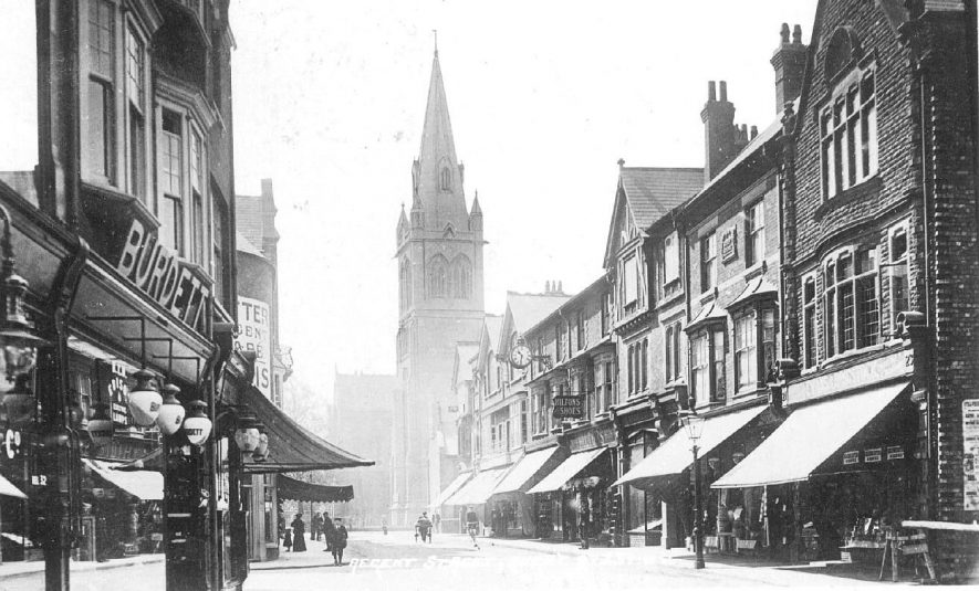Regent Street with St Andrew's Parish church and shops, Rugby.  1910s |  IMAGE LOCATION: (Warwickshire County Record Office)