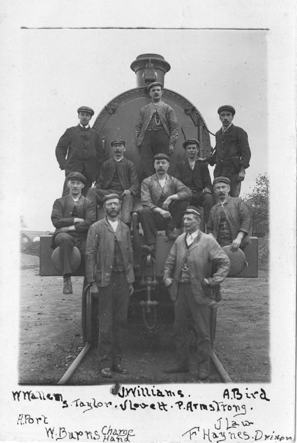 Group of railwaymen standing in front of steam engine, Rugby.  1907 |  IMAGE LOCATION: (Warwickshire County Record Office) PEOPLE IN PHOTO: Williams, J, Williams as a surname, Wallem, W, Wallem as a surname, Taylor, S, Taylor as a surname, Port, A, Port as a surname, Lovett, J, Lovett as a surname, Law, J, Law as a surname, Haynes, F, Haynes as a surname, Burns, W, Burns as a surname, Bird, A, Bird as a surname, Armstrong, P, Armstrong as a surname