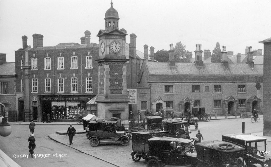 Market Place, Rugby showing cars parked.  1910s |  IMAGE LOCATION: (Warwickshire County Record Office)